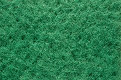 Texture of the pile surface green fibrous sponge, background royalty free stock image