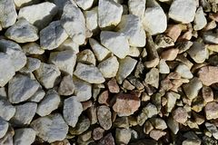 Texture of pile of white and darker decorative stones, diagonal boundary Stock Photography