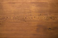 Texture of pine table covered with cherry wax background stock image