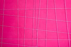 Texture of a pink abstract wall with white geometric lines. Horizontal frame Royalty Free Stock Image