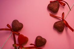 Texture. Pink background. Red hearts with spangles and bows. Tape. St. Valentine`s Day. Blank space of day of an inscription. Texture. Pink background. Red stock photos