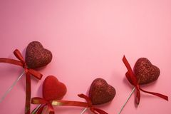 Texture. Pink background. Red hearts with spangles and bows. Tape. St. Valentine`s Day. Blank space of day of an inscription. Texture. Pink background. Red royalty free stock image