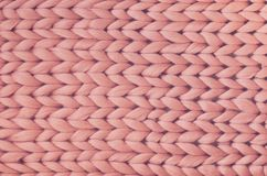 Texture of pink knit blanket. Large knitting. Plaid merino wool. Top view Stock Images