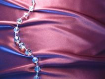 Texture of pink silk with crystal beads. On pink silk with drapery crystal beads Royalty Free Stock Photo