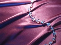 Texture of pink silk with crystal beads. On pink silk with drapery crystal beads Royalty Free Stock Image