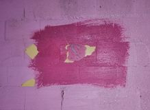 Texture - a pink wall on which a rectangle was smeared with a brush with a careless brush stock photo