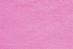 Texture of pink wool knitted fabric close up, abstract textile background royalty free stock photography