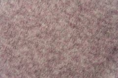 Texture of pink woven wool knitted sweater. Fabric background Royalty Free Stock Images