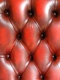 Texture piquée par cuir tufté rouge Images stock