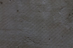 Texture of plaster on a metal grid Stock Photo