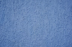 The texture of the plaster on the wall. The texture of the blue plaster on the wall Royalty Free Stock Photo