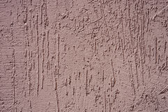The texture of the plaster on the wall. The texture of the brown plaster on the wall Stock Image