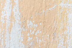 The texture of the plastered wall and carelessly partially painted in peach color. Abstract background Royalty Free Stock Photo