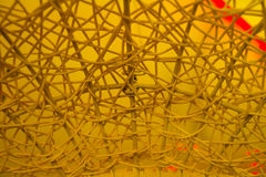 Texture of plastic rattan straw chair on color background.  royalty free stock photography