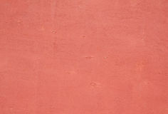 Texture of  plywood covered with pink paint chips Royalty Free Stock Images