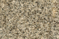 Texture of polished granite rock in gray black. Background of na Royalty Free Stock Image