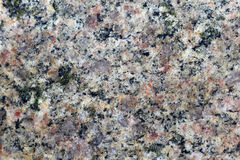 Texture of the polished surface of granite, macro shot Stock Photos