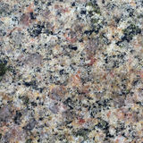 Texture of the polished surface of granite, macro shot Royalty Free Stock Images