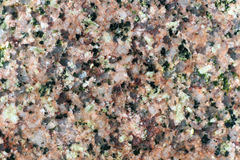 Texture of the polished surface of Herefoss granite, macro shot Royalty Free Stock Photo