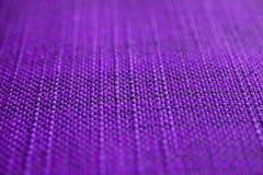 Texture pourprée de tissu Fond pourpre de tissu Fermez-vous vers le haut de la vue de la texture et du fond pourpres de tissu Photo libre de droits