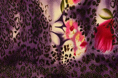 Texture of print fabric striped leopard and flower. For background royalty free stock photo