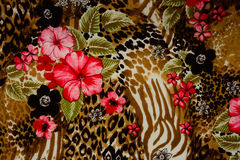 Texture of print fabric striped leopard. And flower for background royalty free stock image