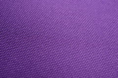 The texture of a purple cotton cloth Royalty Free Stock Image