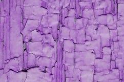 Texture purple paint. Was polushilos on painted wood Stock Photos