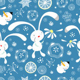 Texture of rabbits. Seamless pattern from the gay rabbits on a blue background with snowflakes Stock Images