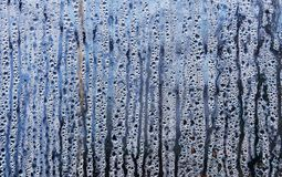 Texture of rain drops on a glass wet transparent surface