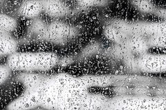 Texture Raindrops on window glass for rain, black and white colors, photo, unusual background Stock Photos