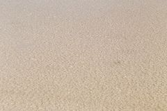 Texture of raw salt under sea water in evaporation ponds process Royalty Free Stock Photo