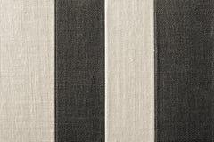 Texture rayée de couleur noir-beige de tissu rugueux Images libres de droits