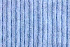 Texture rayée tricotée de laine bleu-clair de tissu Image stock