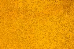 Texture. the real textured plaster painted in orange color. Royalty Free Stock Images