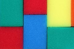 Texture rectangular sponges for washing dishes of different colors royalty free stock images