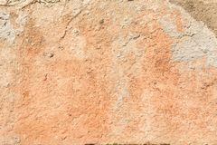Texture of a red antique wall, destruction of a plaster layer of an old concrete surface, abstract background Stock Photography