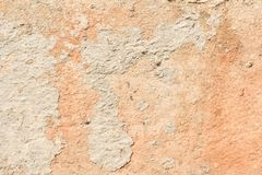 Texture of a red antique wall, destruction of a plaster layer of an old concrete surface, abstract background Stock Image