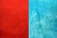 Texture of red and blue shabby paint stucco background Stock Image