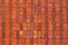 Texture of a red brick stacked as a background stock photo