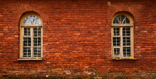 Texture of red bricks with arched windows. Wall of an old house. Texture of red bricks with arched windows Royalty Free Stock Photo