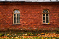 Texture of red bricks with arched windows. Wall of an old house. Texture of red bricks with arched windows Stock Image