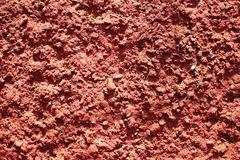 Texture of red bumpy cement wall. Close up royalty free stock image