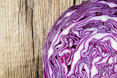 Texture of red cabbage cut in half on wooden table stock images