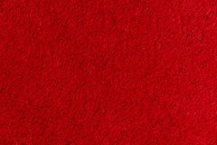 Texture of a red carpet with a short nap. Red carpet background. stock image