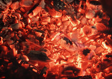 Texture from red coals in fireplace Stock Photos