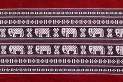 Texture of red cotton fabric. Texture of red cotton fabric, with white woven fabric elephant Stock Photo