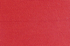 Texture of red fabric, roughly woven, background Stock Image