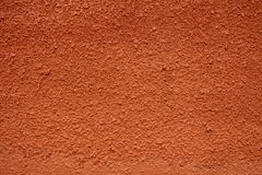Texture of red plastered wall for background. stock photography