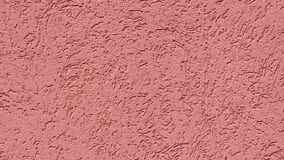 Texture red plastered wall with a pattern royalty free stock photo